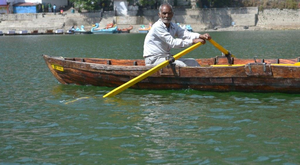 A boatman rows past at Nainital