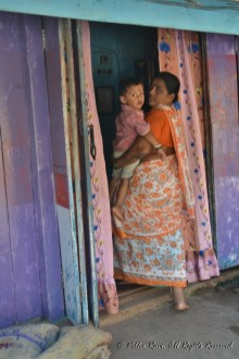 Lady with grandchild Malvan