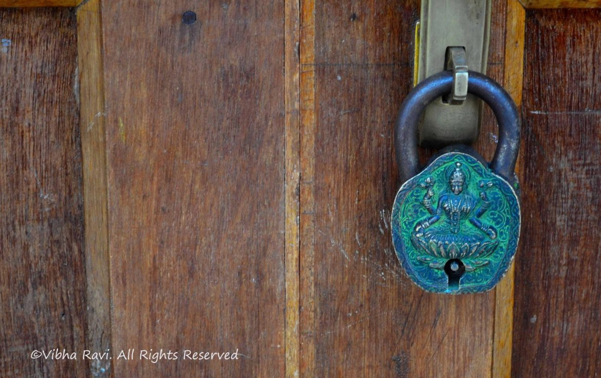 Embossing of the Goddess of wealth, Mahalaxmi on a lock