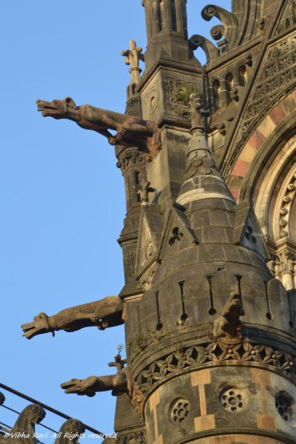 Gargoyles seem ready to jump at his signal