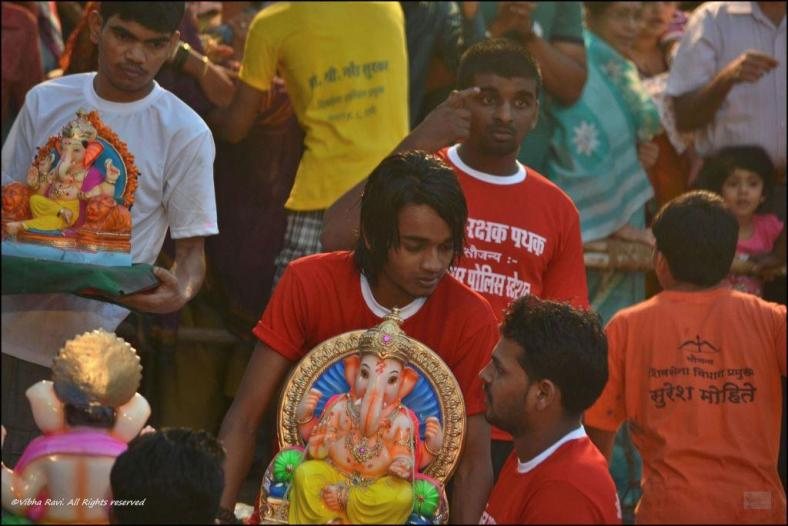 Handing over Ganapati idol to volunteers for immersion
