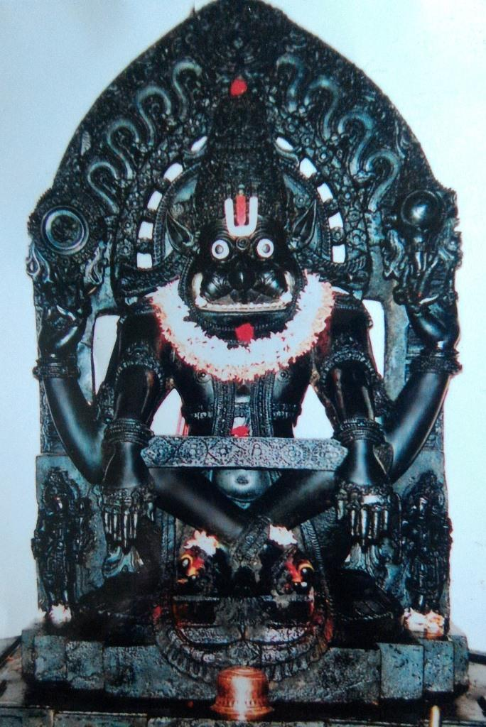 Yoganarasimha idol at Veera Narayana Temple. He is sitting in a tough yoga posture, supported by a cloth around his knees called yogapatti