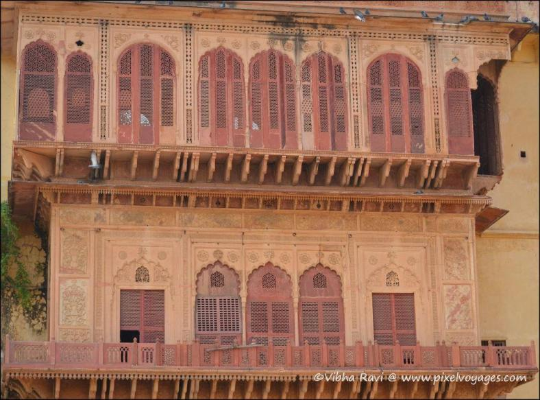 Jharokhas (balconies) and chhatris (domed pavilions) are integral to Rajasthani architecture. The City Palace in Alwar is no exception