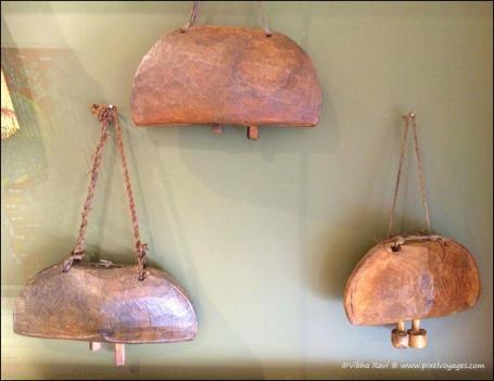 Indian tribal cow bells. With bodies of metal, they have wooden or metal clappers