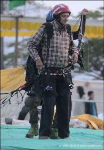 Putting on paragliding gear in Saputara