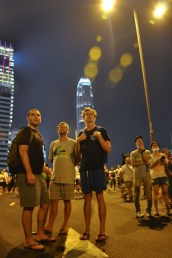Surprised caucasian onlookers survey what's ahead