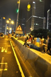 Admiralty. Roads of devoid of vehicles. A man sleeps on the foyer concrete ledge