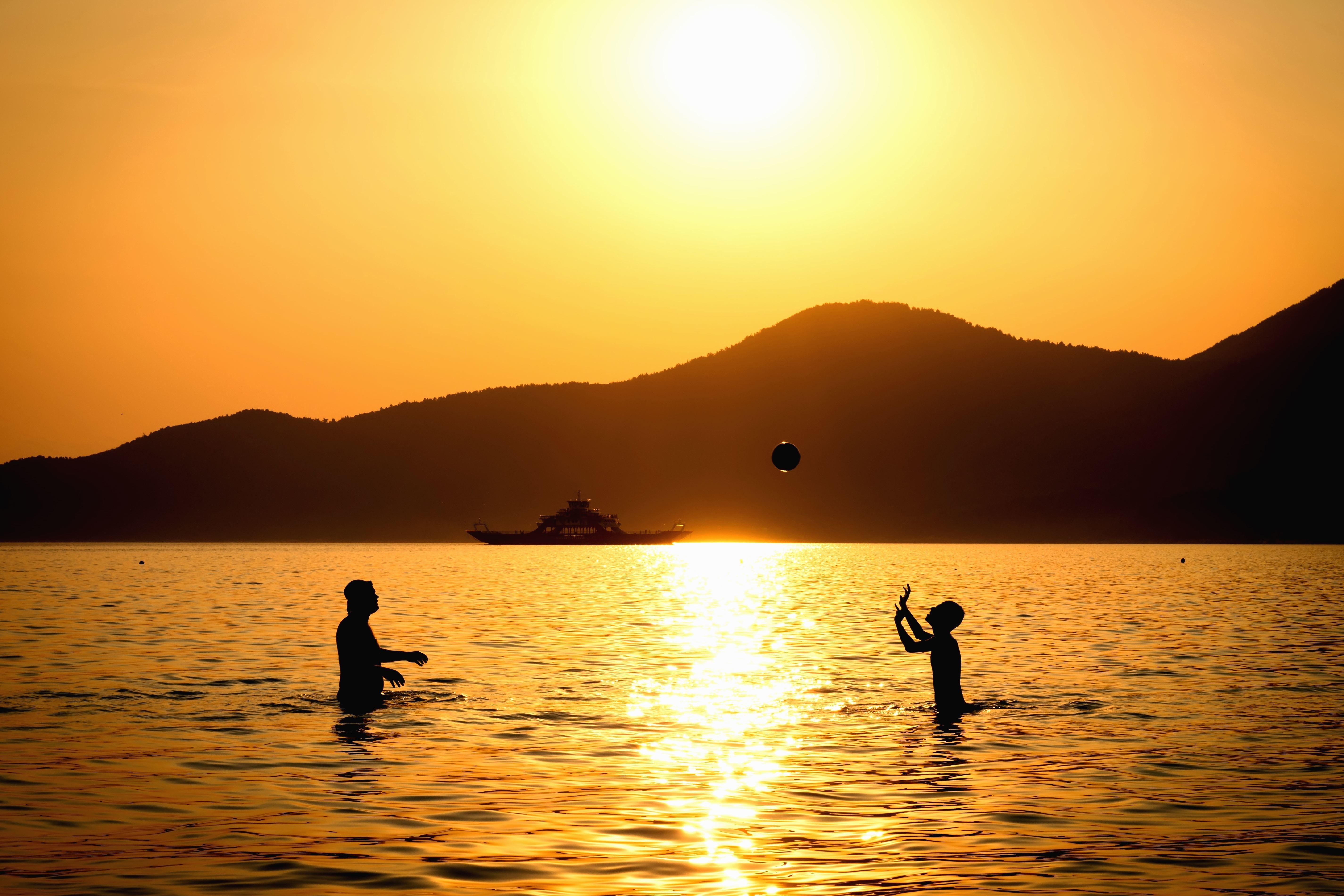 Free picture silhouette people sea sunset water game ball mountain