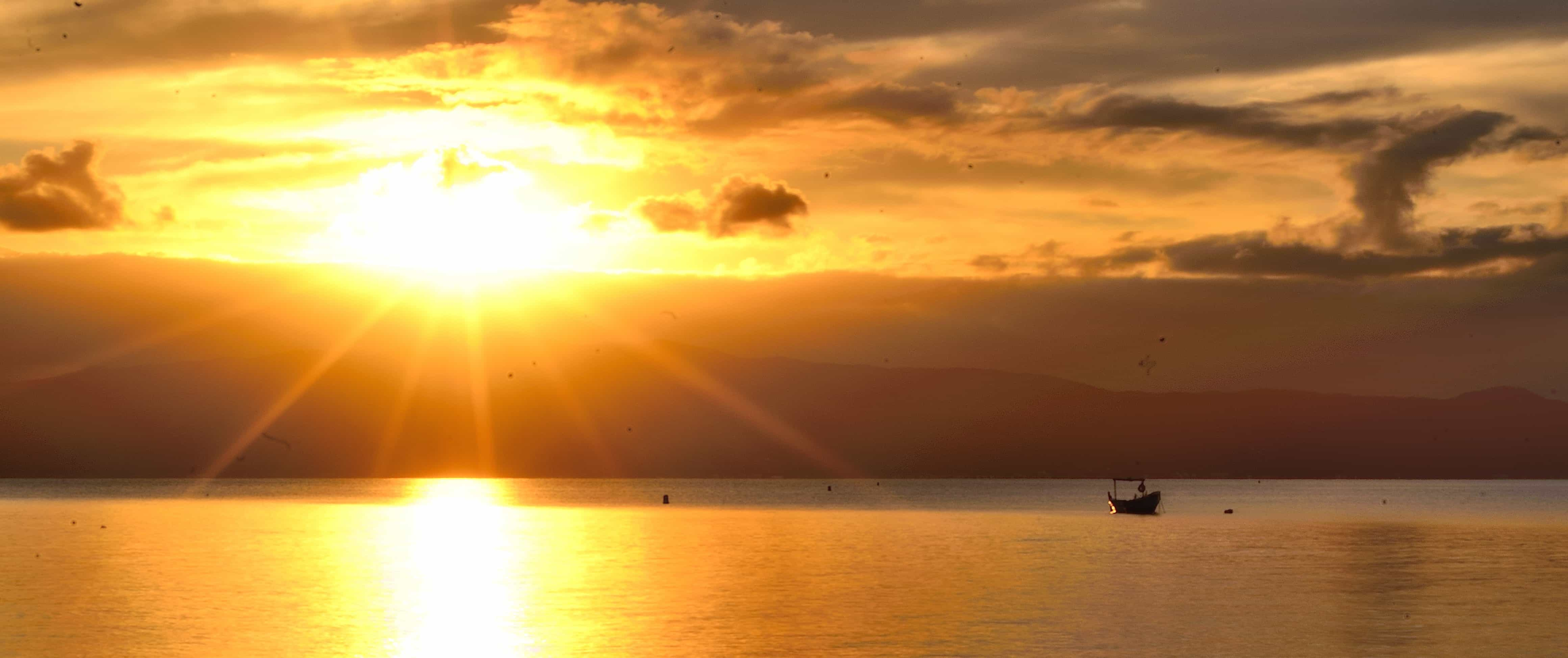 Foto gratis sole alba alba acqua sole mare spiaggia tramonto luce solare