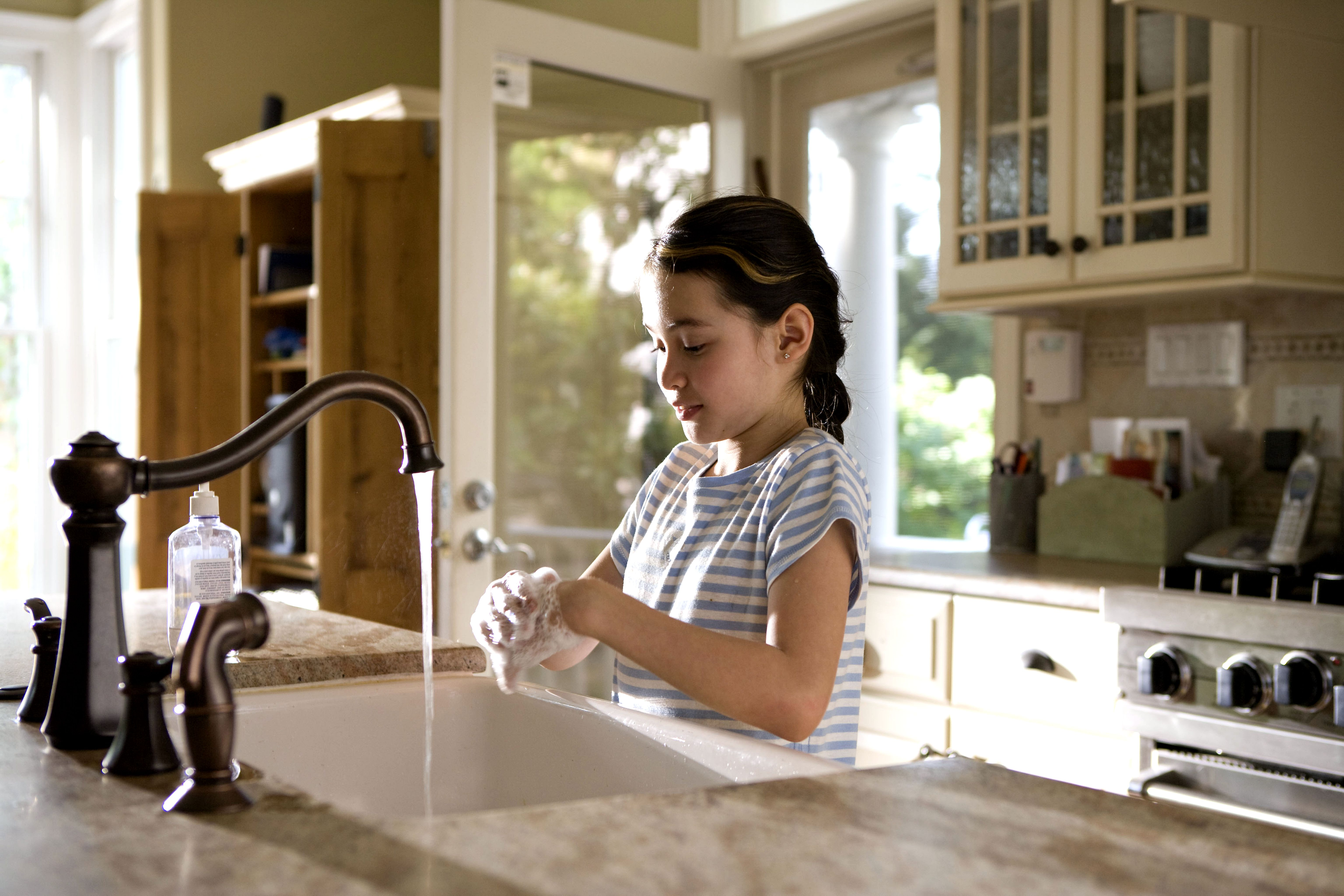Free picture young girl shown process washing hands