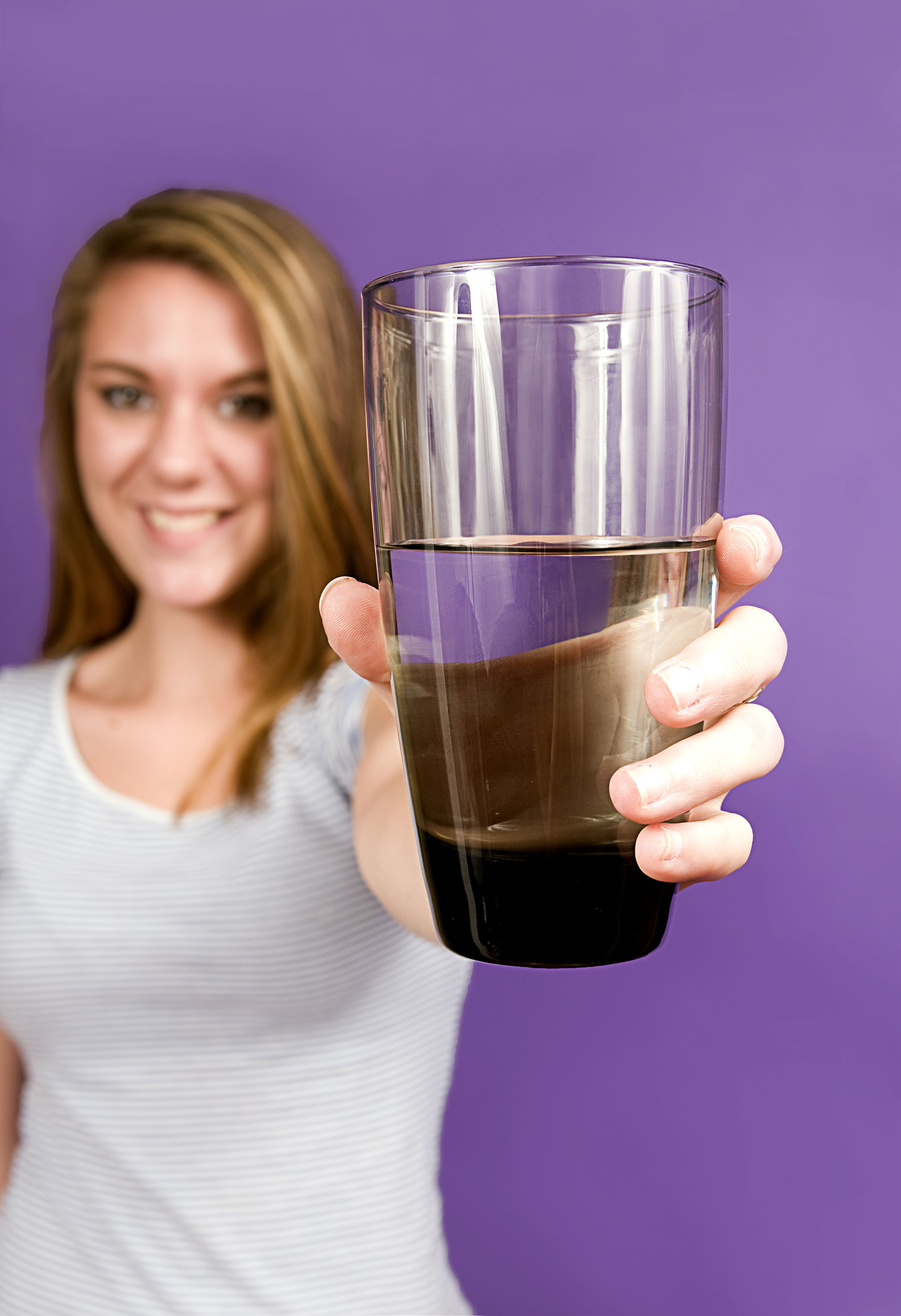 Free picture cute young woman offering clean glass water