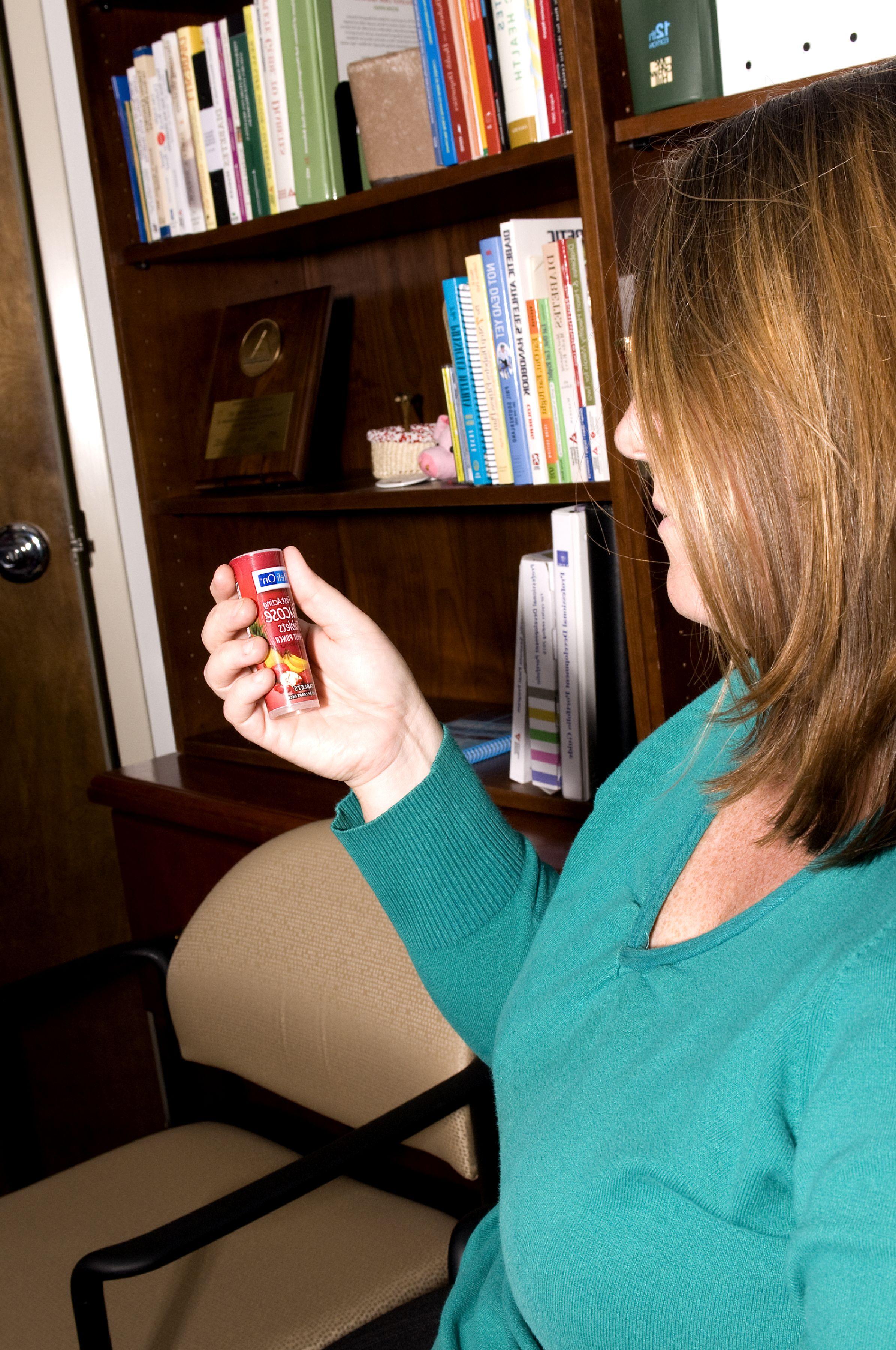 Free Picture Female Diabetic Patient Reading Label