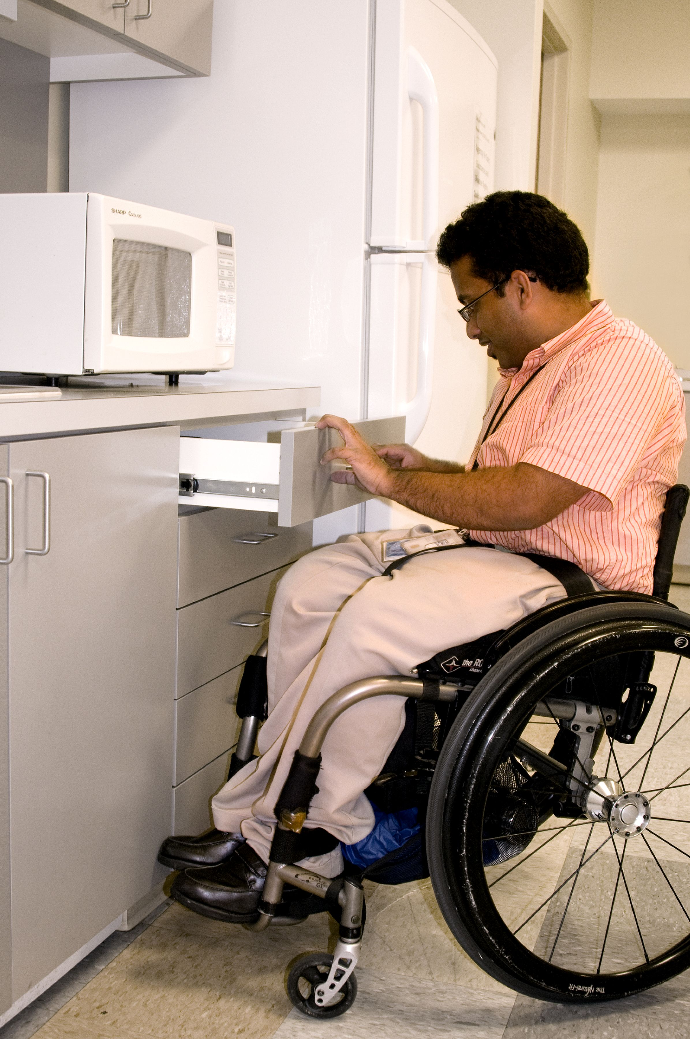 Free picture man wheelchair kitchen setting opening
