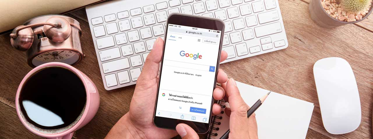 Mobile phone with Google on the screen - 20 Easy to Use WordPress SEO Tips, Tricks, and Resources