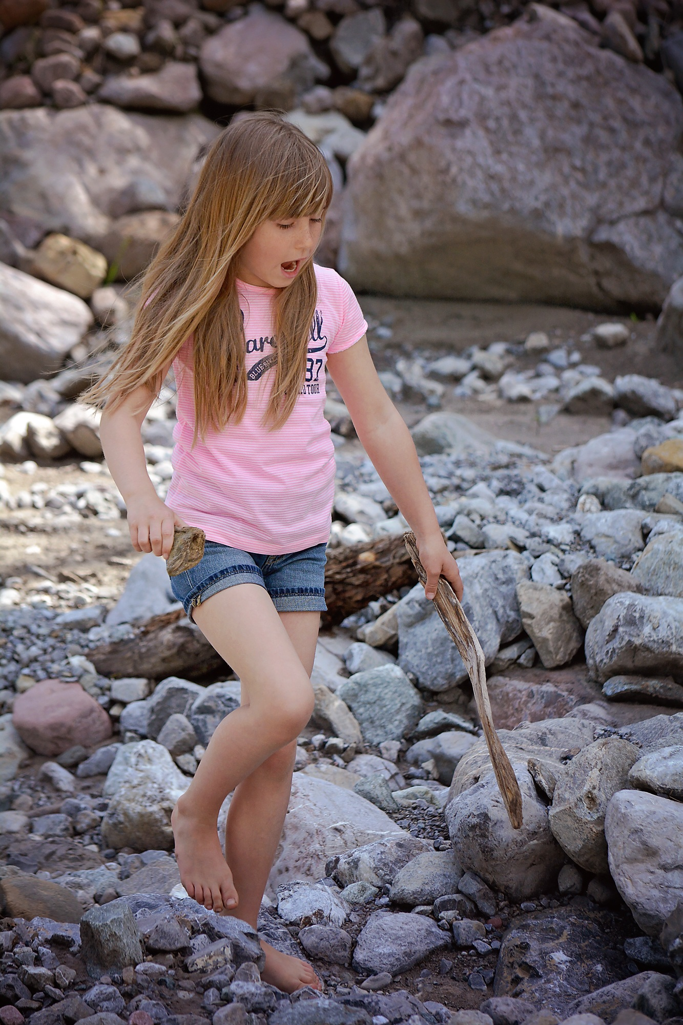Little Girl With Long Hair On The Rocks Near The Pond Free