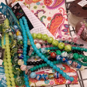 Beads for bracelets and fabric for dolls :)