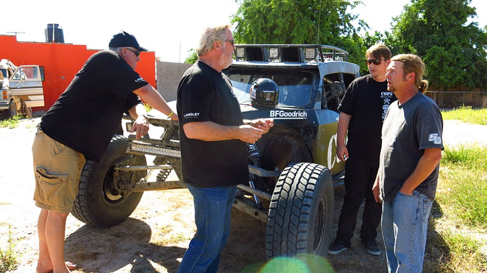 John Langley, Team Owner, discusses the day's logistics with Morgan and Bill.