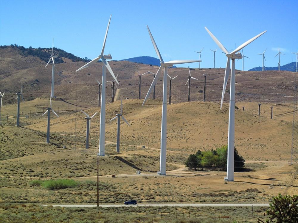 Wind turbines towering over Oak Creek Road, near Mojave, California.