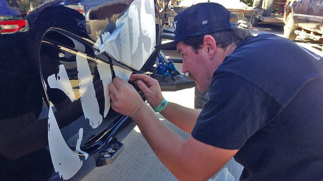 Brad carefully applies COPS branding to the new ES-Motorsports-built Class 1 car.