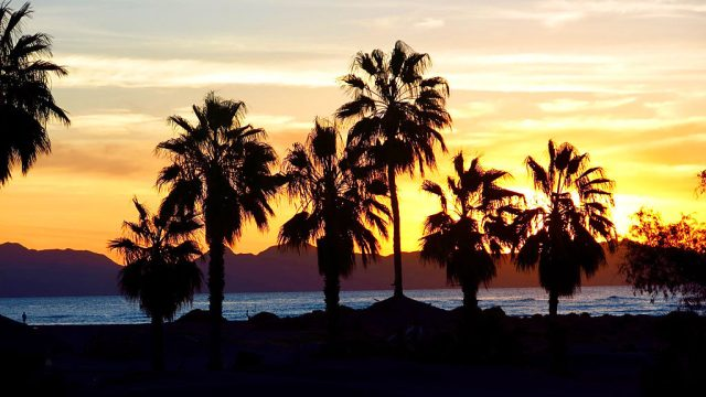 Sunrise over Island Carmen offshore from Loreto. Our prerunning day begins.