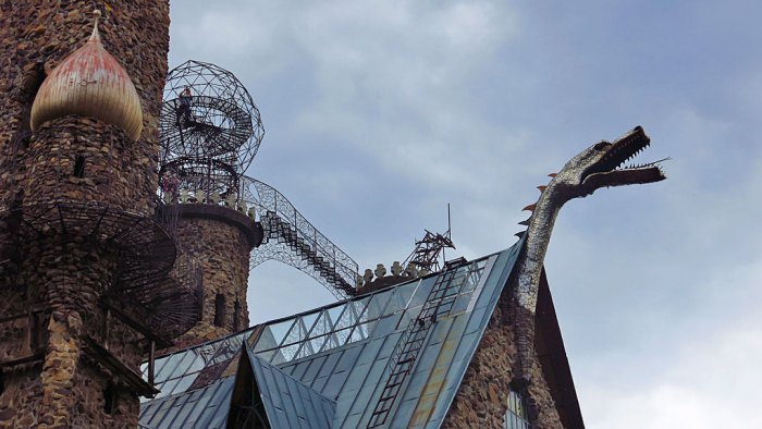 The stainless steel dragon head adorns the top of chimney and occasionally belches fire and smoke from a downstairs fireplace.