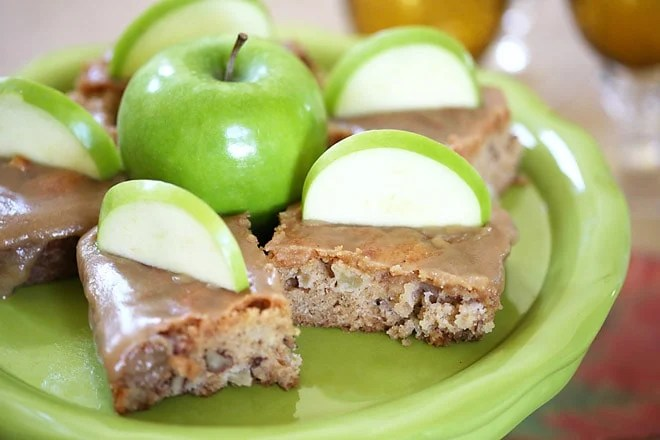 You will love this easy apple cake recipe that is topped with a brown sugar glaze that is to die for! It's always a crowd-pleasing recipe!