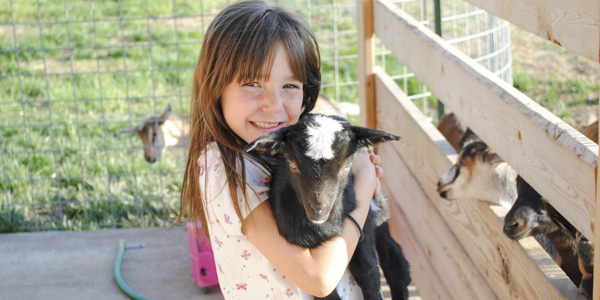 jade holding goat_blog