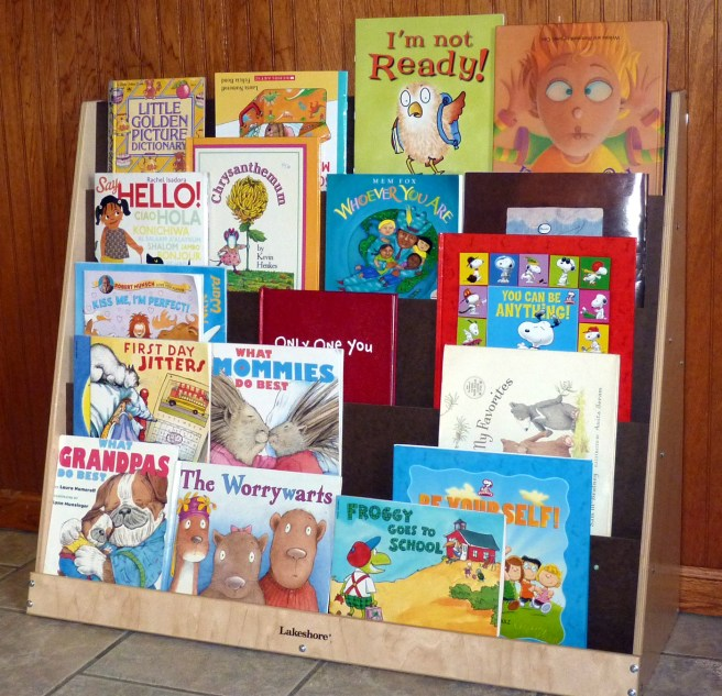 Library– I'm developing alphabet knowledge, oral language, print knowledge, listening skills, eye-hand coordination, concepts about the world, and the desire to read. Maybe I'll be a publisher, author, or librarian when I grow up.