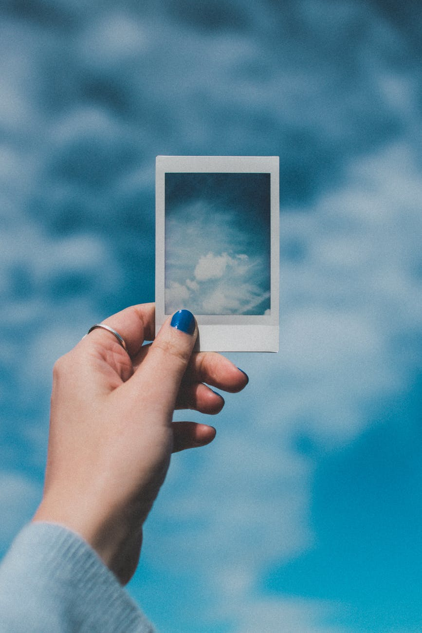 person holding cloud photo