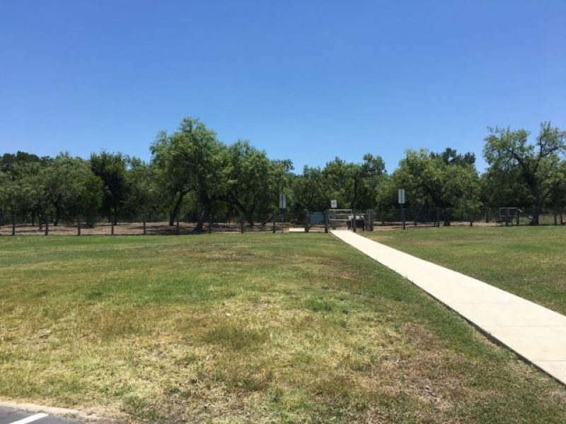 The sidewalk at South Side Lions Dog Park is very long.