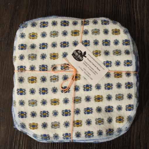square of white fabric with blue and gold geometric print
