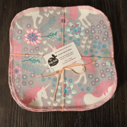 square of grey fabric with pink and white unicorns and flowers