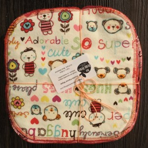 Cream Square of fabric with doodles of bears and text that reads: Adorable, Cute, Huggable, Hugs, Super