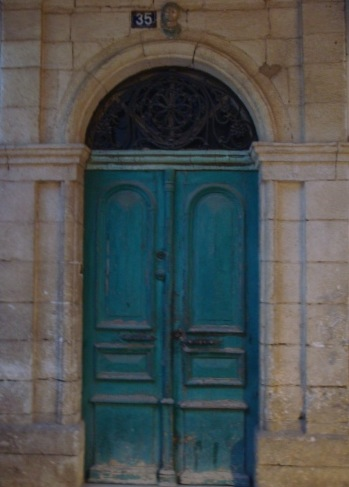 I have this exact same door in a watercolor painting I bought 2 years ago. I wonder if it's from Chania originally.