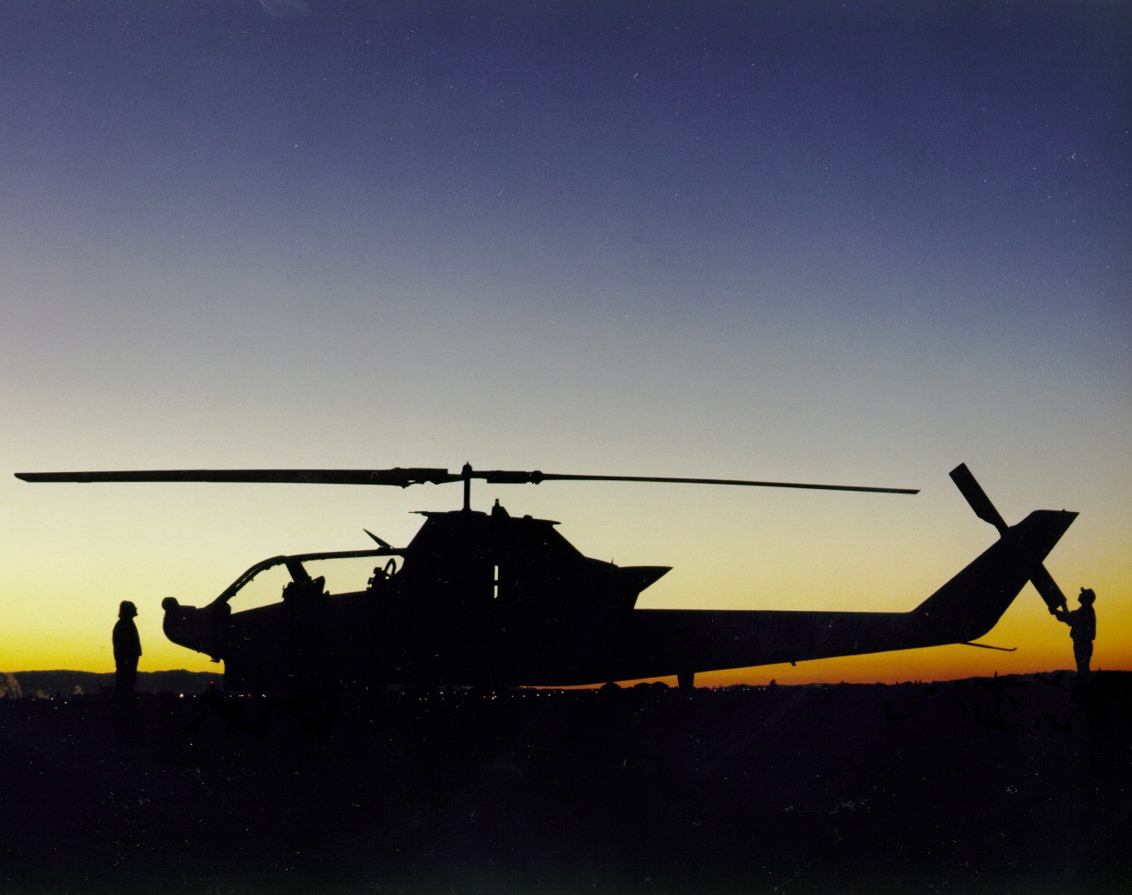 A TH-1S (NASA-736) Cobra helicopter at sunrise on the ramp at the NASA Ames Research Center, Moffett Field, California.