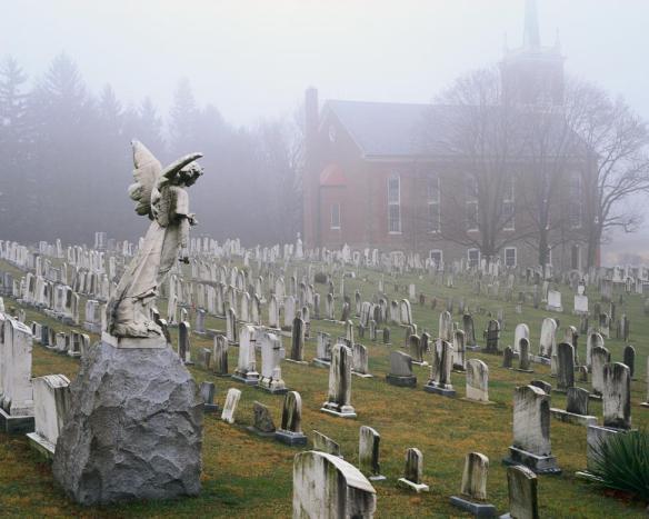 Foggy weather in a church graveyard