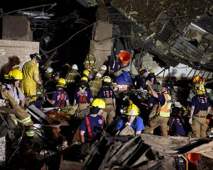 Rescue workers continue their search AP photo