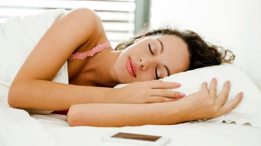 How to manifest money overnight woman sleeping in bed