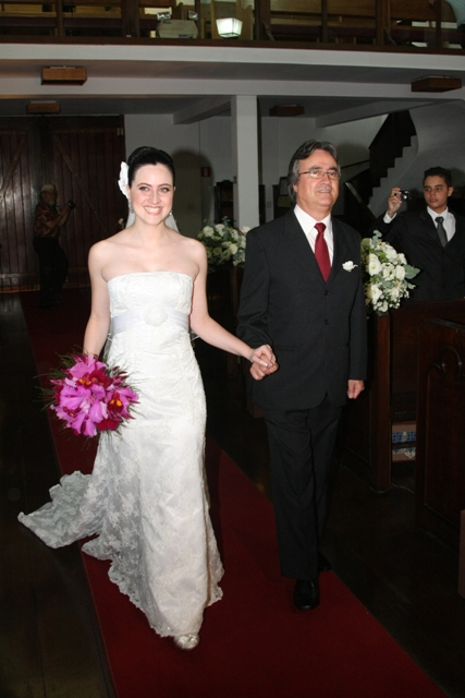 Father carrying daughter to get married