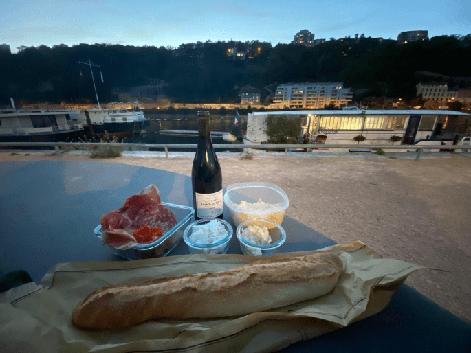 Picnic by the river during summer in Lyon France