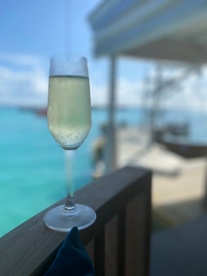 Glass of sparking wine at resort in the Maldives