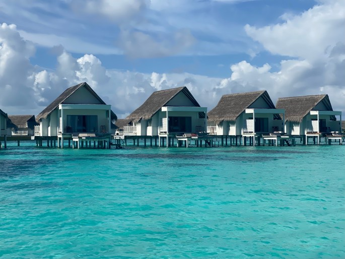 maldives over the water ocean hut rooms with teal water