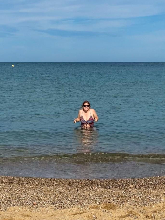 girl in ocean in barcelona spain