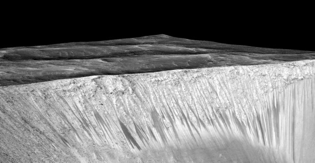 RSL emanating out of the walls of Garni crater. The streaks are narrow, but up to several hundred metres in length. Image Credit: NASA/JPL/University of Arizona