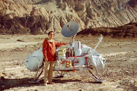 Carl Sagan posing with a model of the Viking 1 lander in Death Valley, Calif. Photo Credit: NASA