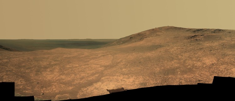Panoramic view of Marathon Valley as seen by the Opportunity rover. The interior of Endeavour Crater lies in the distance. Soon, the rover will move southward to examine a gully thought to have been carved by water long ago. Photo Credit: NASA/JPL-Caltech/Cornell Univ./Arizona State Univ.