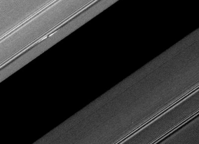 "One of the bright ""propeller"" features in Saturn's A ring (upper left). Photo Credit: NASA/JPL/Space Science Institute"