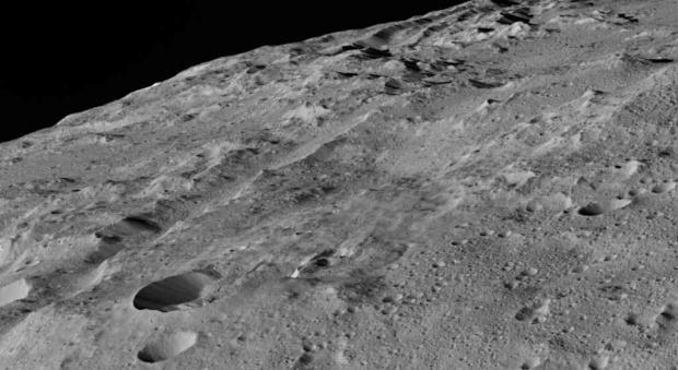 One of the first new images taken in Dawn's lowest orbit around Ceres, showing the crater chain called Gerber Catena. Photo Credit: NASA/JPL-Caltech/UCLA/MPS/DLR/IDA
