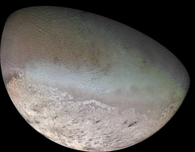 "Neptune's largest moon Triton has unusual ""cantaloupe"" terrain and geysers of nitrogen. Photo Credit: NASA/JPL-Caltech"