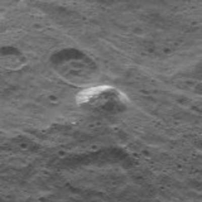Close-up view of the odd conical mountain on Ceres, which is thought to be composed of solid ice. Photo Credit: NASA/JPL-Caltech/UCLA/MPS/DLR/IDA